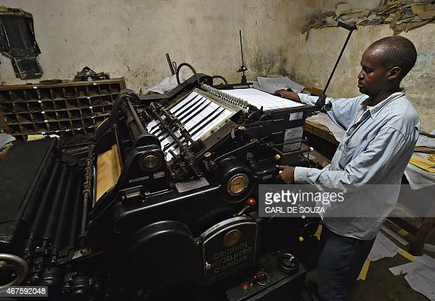 A man operates an old original Heidelberg printing press at the Daha printing press in Mogadishu on March 26 2015 The vintage Germanbuilt machine was...