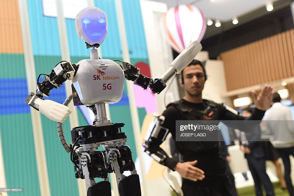 A man operates an SK telecom robot during the 2015 Mobile World Congress in Barcelona on March 3 2015 Phone makers will seek to seduce new buyers...