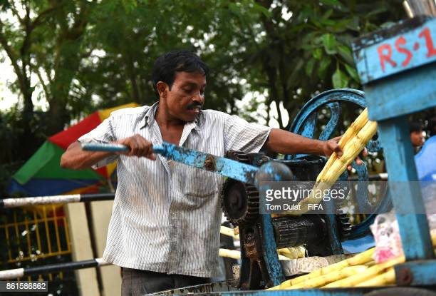 A man operates sugar cane juice squeezer during the FIFA U17 World Cup India 2017 tournament at on October 15 2017 in Guwahati India