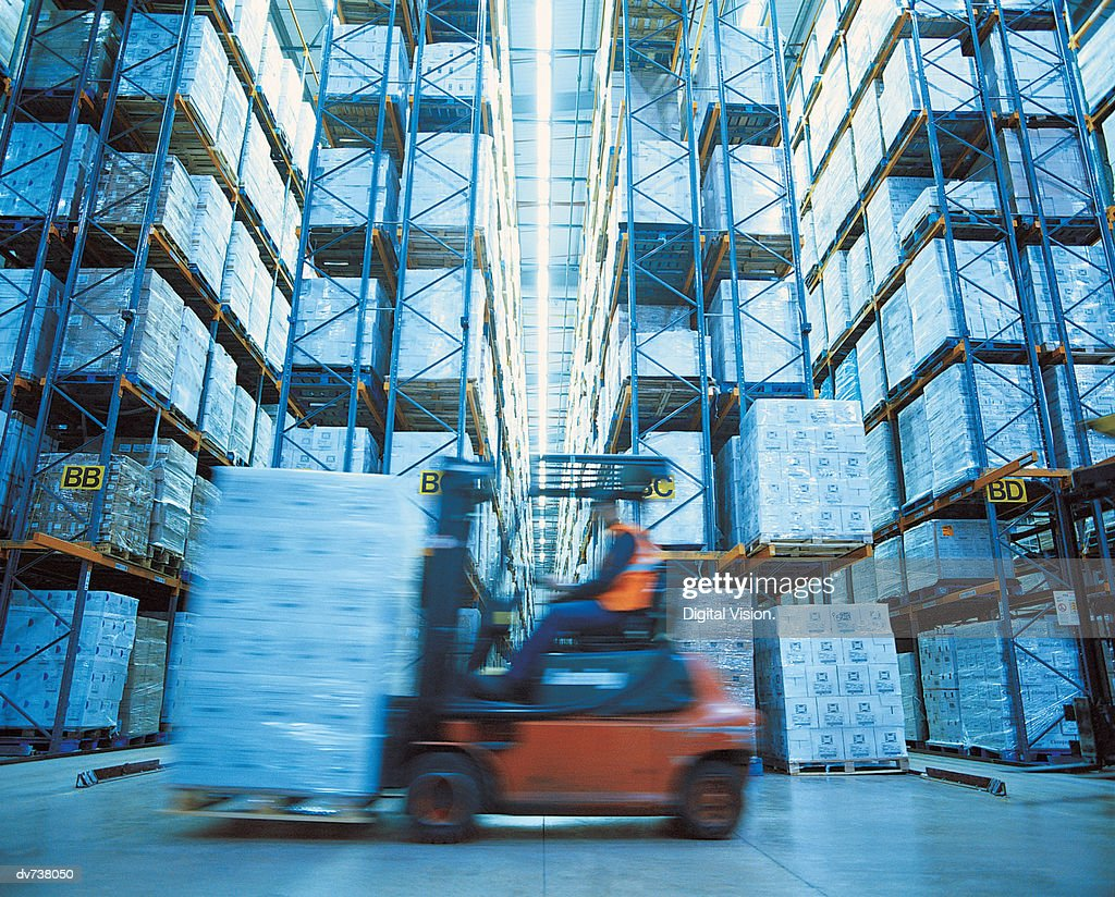 Man Operating Forklift in Warehouse : Stock Photo