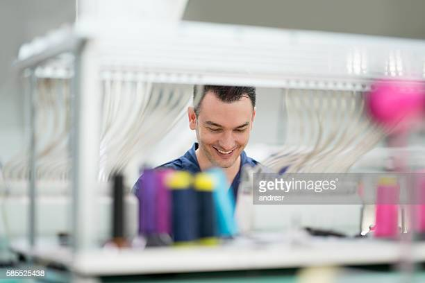 Man operating the embroidery machine