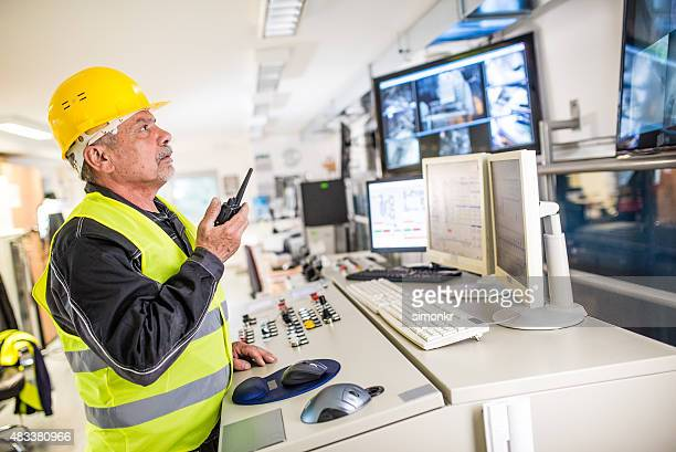 Man operating walkie-talkie at recycling plant