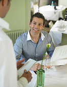 Man ordering from menu in restaurant