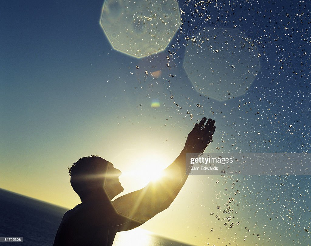 Man outdoor splashing in a body of water : Stock Photo