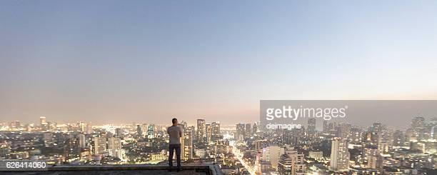 Man over top skyscraper