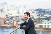 man overlooking city from elevated view.
