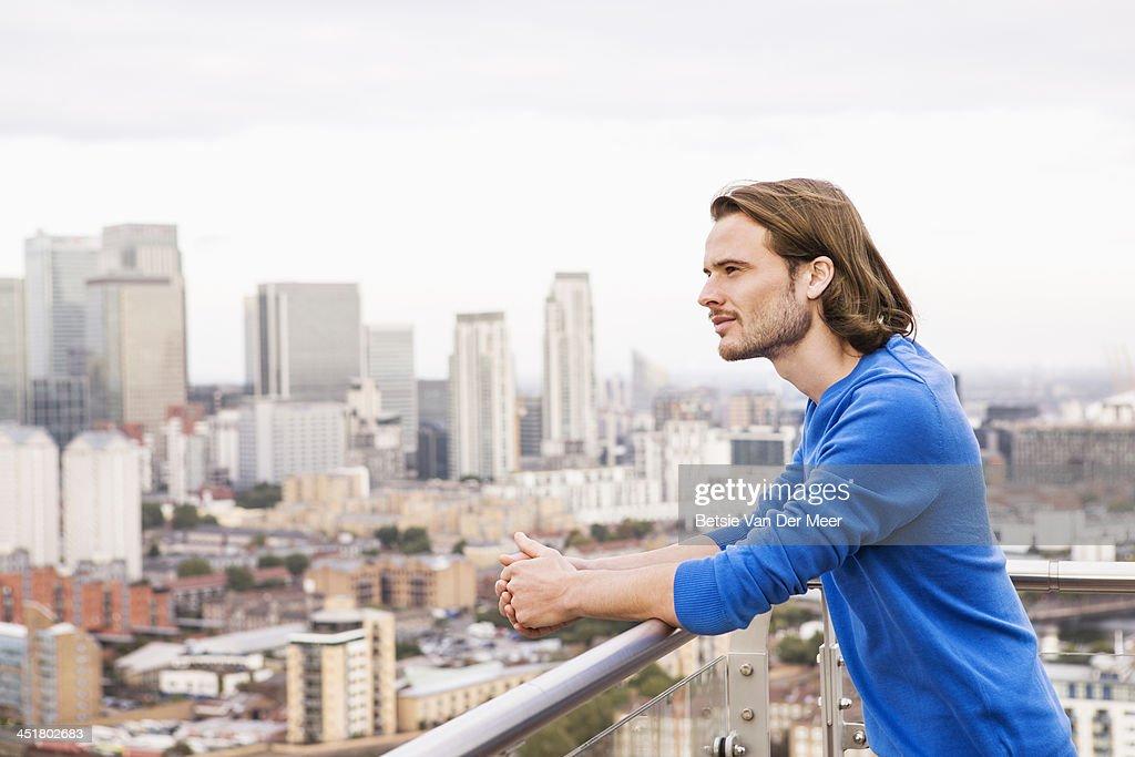Man overlooking city : Stock Photo