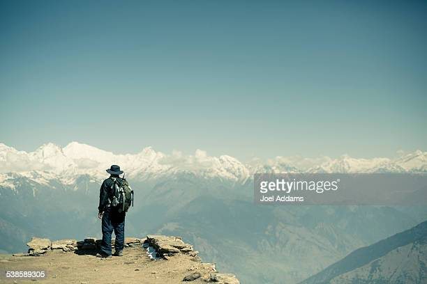 Man overlooking the Himalayas.