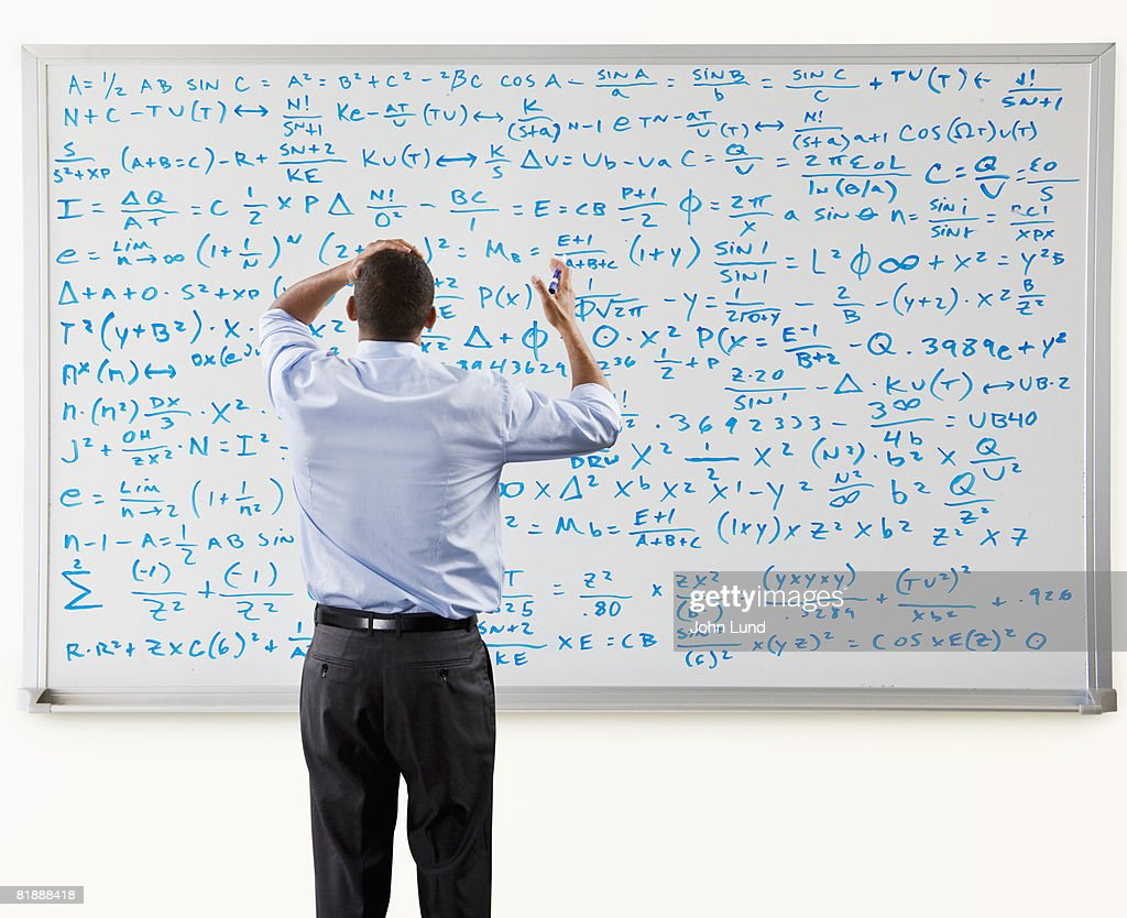 Man Overwhelmed In Front Of Large Math Problem : Stock Photo