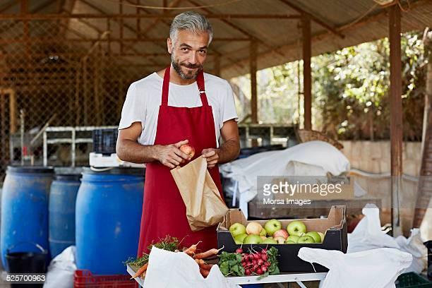 Man packing fresh apples at organic farm
