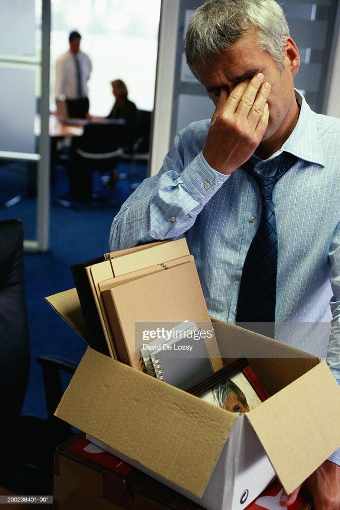 Man packing up office belongings