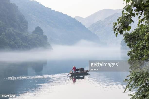 Man paddling boat in river