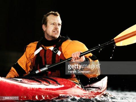 Man paddling in kajak : Stock Photo