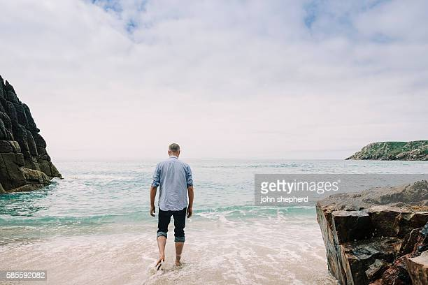 Man paddling in the sea