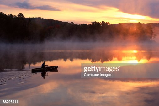 Man paddling solo canoe on Oxtongue Lake