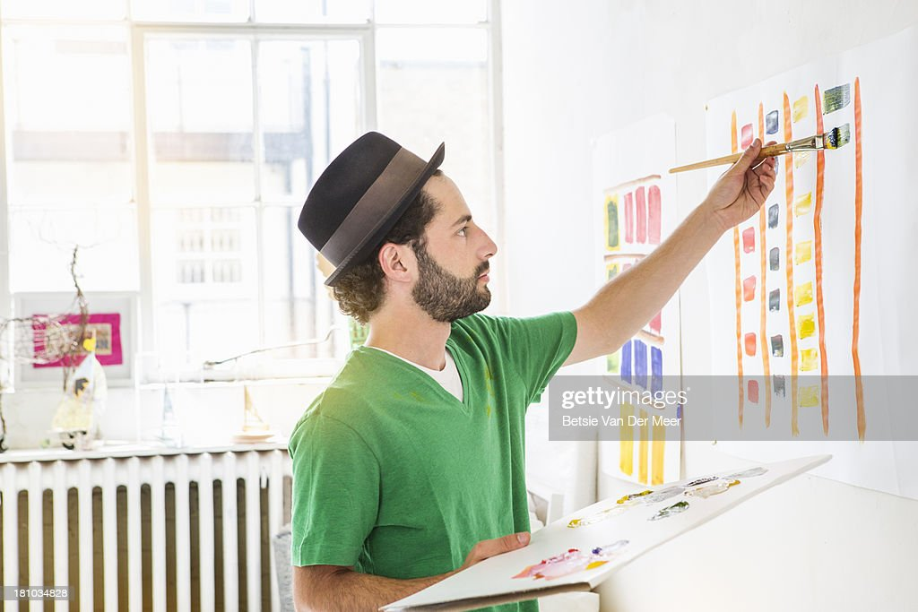 Man painting abstract painting in art studio