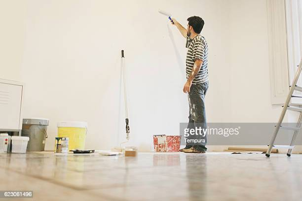 Man  painting apartment.
