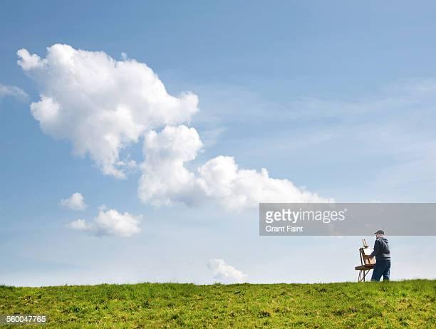Man painting cloud