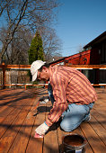 Man Painting Deck