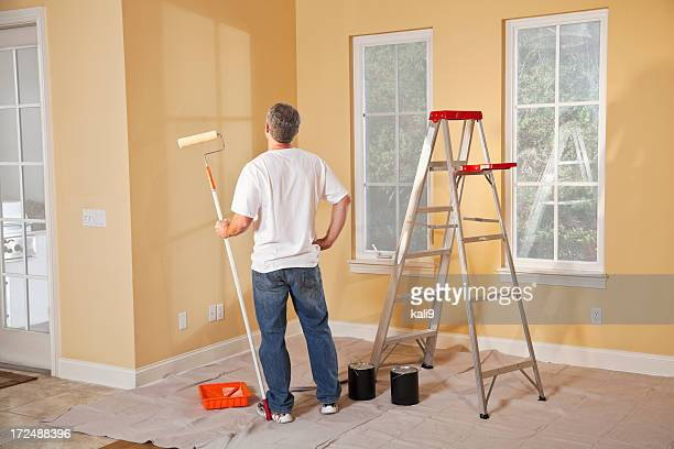Man painting home interior