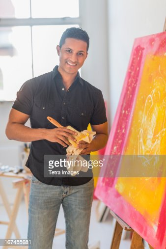 Man painting in studio : Stock Photo