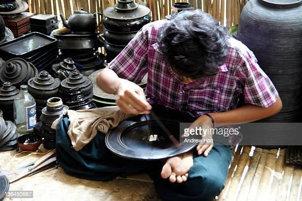 Man painting lacquerware in Bagan, Myanmar (Burma)