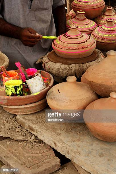 Man Painting Terracotta Pots Bright Colors