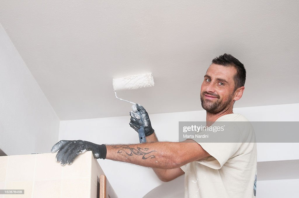 Man  painting wall and ceiling : Stock Photo