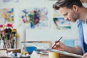 Man painting watercolour.
