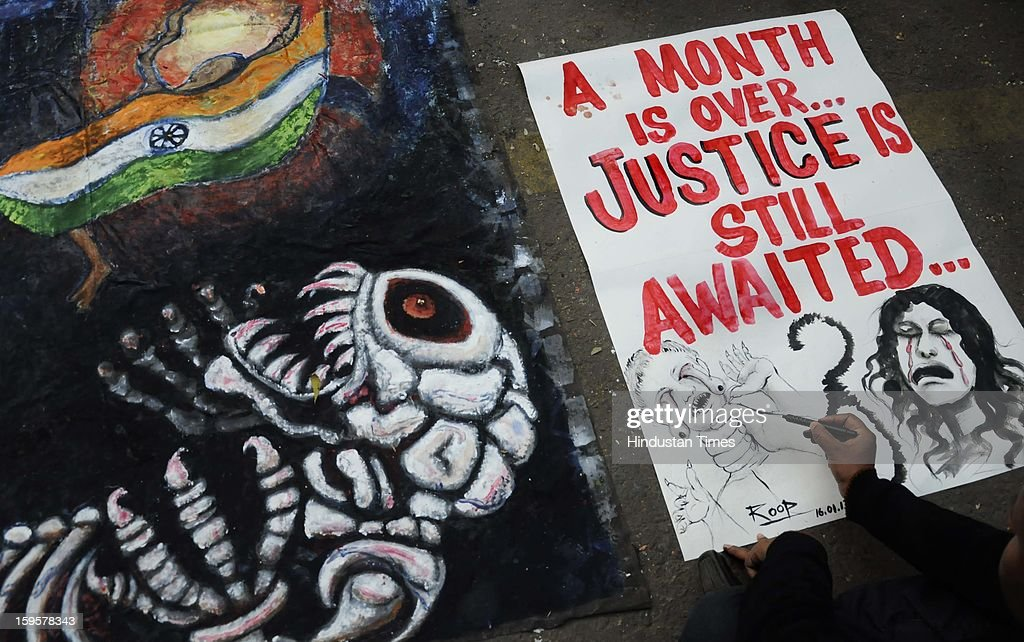 A man paints a poster during the protest against the alleged inaction by the Indian government regarding the gang rape of a 23-years old student in a bus a month ago, on January 16, 2013 in New Delhi, India. The bus rape has drawn protests and intense media attention. Rapes have become front-page news nearly every day across the country, with demands that police do more to protect women and that the courts treat sexual violence seriously.