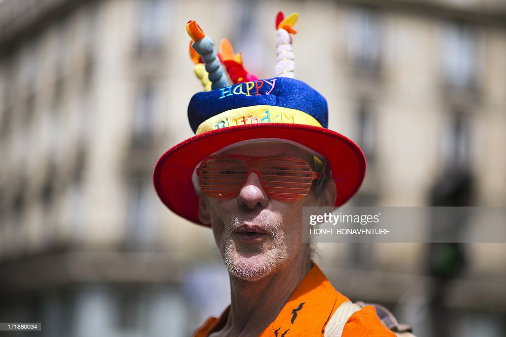 A man parades during the homosexual, lesbian, bisexual and transgender (HLBT) visibility march, the Gay Pride, on June 29, 2013 in Paris, exactly one month after France celebrated its first gay marriage. AFP PHOTO / LIONEL BONAVENTURE