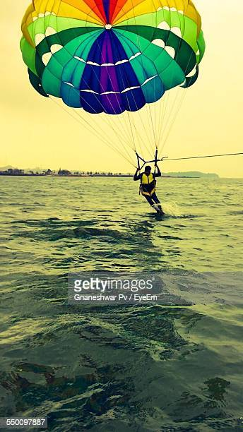 Man Parasailing Against Sky
