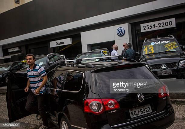 A man parks his car outside a Volkswagen AG auto dealership in the Botafogo neighborhood of Rio de Janeiro Brazil on Thursday July 9 2015 Brazil's...