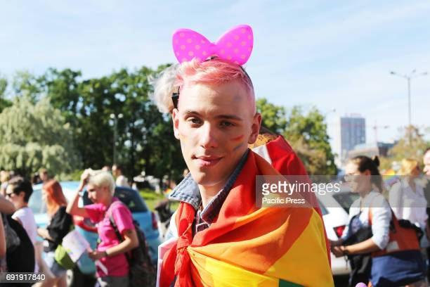 A man partaking in the Warsaw Pride Parade poses for a photo Thousands of people from across Poland and Europe took part in the Warsaw Pride parade...