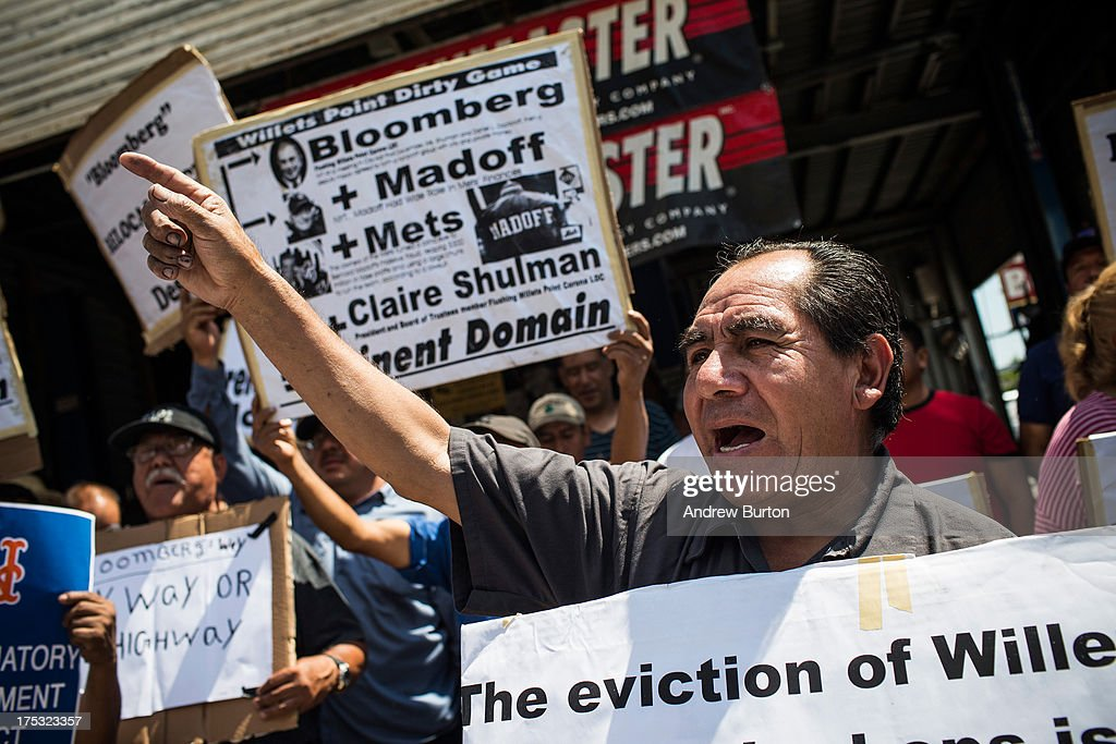 A man participates in a protest against the eviction of over two hundred small businesses on August 2, 2013 in the Willet's Point neighborhood of the Queens borough of New York City. The neighborhood has been in a battle with the city of New York for years, which hopes to demolish the neighborhood and invest $3 billion for a mall, apartments and more parking for nearby Citi Field. Members of the neighborhood argue that hundreds of small businesses are established in the neighborhood and should not be evicted.