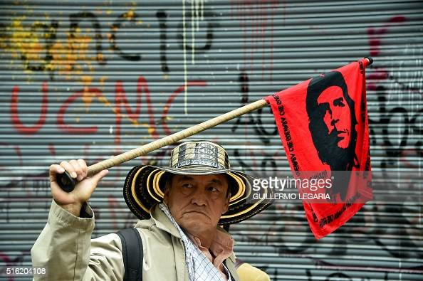A man participates in a protest march in Bogota on March 17 2016 as part of a national strike organized by labor unions to protest against the...