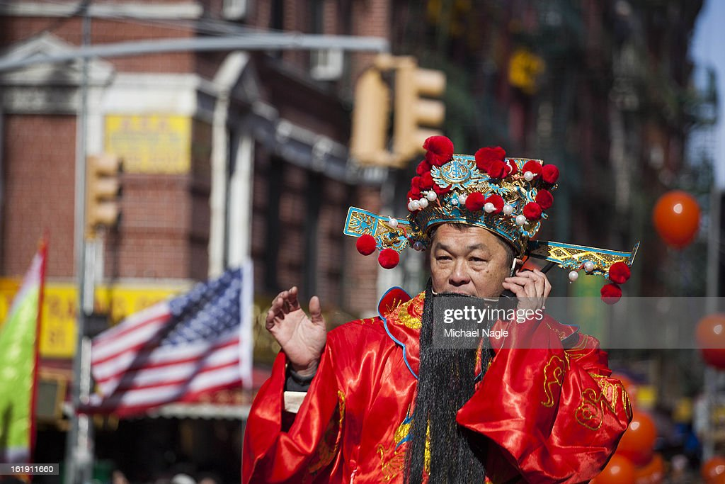 A man participating in the 14th Annual Chinatown Lunar New Year parade coordinates over a two-way radio on February 17, 2013 in New York City. This year celebrates the Year of the Snake.