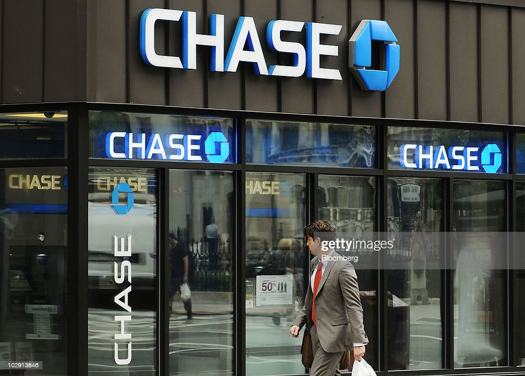 A man passes a JPMorgan Chase Co bank branch in New York US on Thursday July 15 2010 JPMorgan the secondbiggest US bank by assets said profit rose 76...