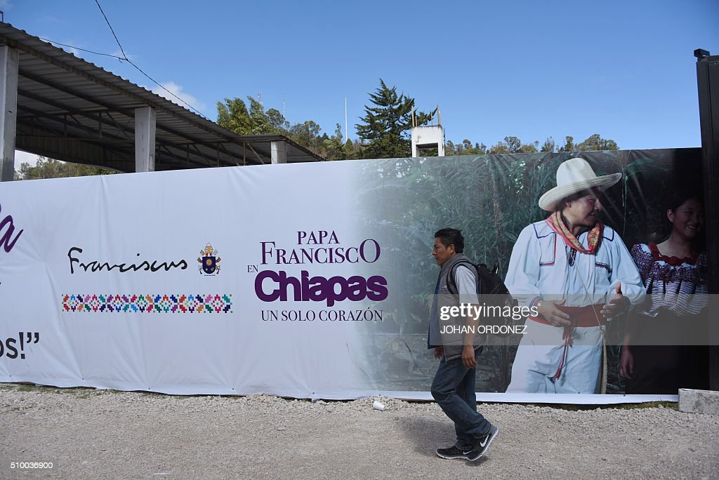 A man passes by a banner welcoming Pope Francis near the place where he will officiate an open-air mass in San Cristobal de las Casas, Chiapas State, Mexico on February 13, 2016. ope Francis urged Mexican bishops Saturday to take on drug trafficking with 'prophetic courage,' warning that it represents a moral challenge to society and the church. AFP PHOTO/Johan ORDONEZ / AFP / JOHAN ORDONEZ