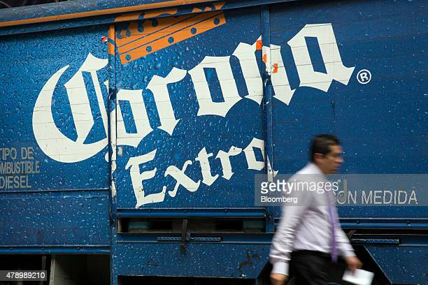 A man passes by a delivery truck with Constellation Brands Inc Corona beer in the Zona Rosa neighborhood in Mexico City Mexico on Wednesday June 24...