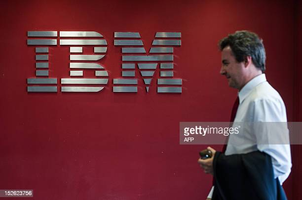 A man passes by a logo at IBM office in Hortolandia about 100km north from Sao Paulo Brazil on September 14 2012 AFP PHOTO/Yasuyoshi CHIBA