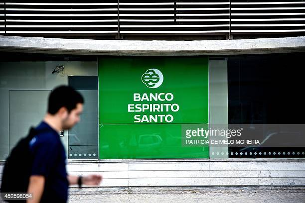 A man passes by BES branch in Lisbon on July 24 2014 Portuguese bank Banco Espirito Santo former director Ricardo Salgado recently forced to quit as...