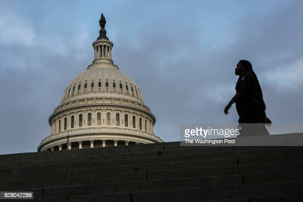 A man passes by the East side of the US Capitol on July 28 2017 in Washington DC after the Senate failed to pass a measure to repeal parts of the...