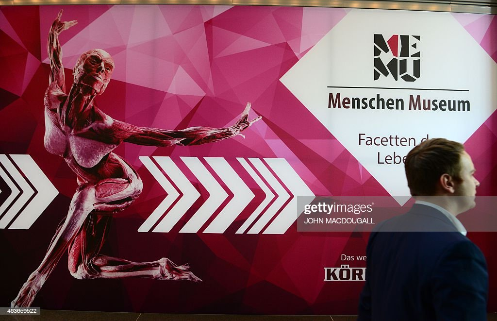 A man passes by the entrance of the 'Menschen Museum' (Human Being Museum) reading 'Body Worlds' by German plastinator <a gi-track='captionPersonalityLinkClicked' href=/galleries/search?phrase=Gunther+von+Hagens&family=editorial&specificpeople=226597 ng-click='$event.stopPropagation()'>Gunther von Hagens</a> is pictured on the eve of its opening in Berlin, on February 17, 2015. German anatomist <a gi-track='captionPersonalityLinkClicked' href=/galleries/search?phrase=Gunther+von+Hagens&family=editorial&specificpeople=226597 ng-click='$event.stopPropagation()'>Gunther von Hagens</a>, dubbed 'Doctor Death' for preserving and displaying dead bodies as artworks, opens a museum dedicated to the technique called plastination, after 20 years of touring the world with this controversial exhibition of human complete corpses and organs. MACDOUGALL