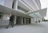 A man passes by the main entrance of the World Bank headquarters main complex September 18 2000 in Washington DC