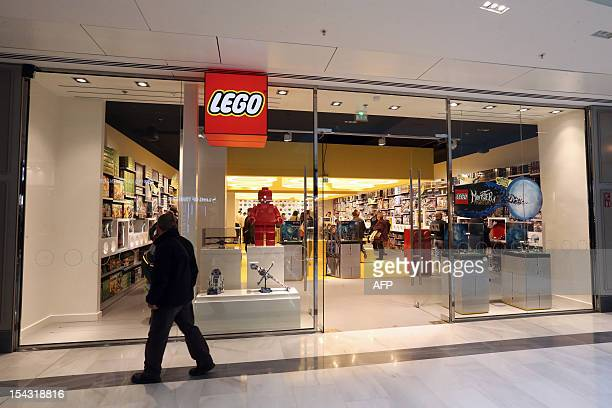 A man passes by the newlyopened store of Danish construction toys group Lego on October 18 2012 at the 'So Ouest' shopping center in LevalloisPerret...