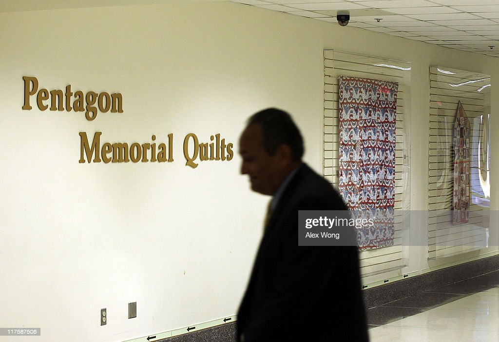 A man passes by the Pentagon Memorial Quilts Corridor where 21 quilts, of more than 100 in the collection that serve as a historical record of the tragic events of 9/11, are on display June 28, 2011 in Arlington, Virginia. This year is the 10th anniversary of the September 11 terrorist attacks, in which 184 people were killed at the Pentagon.