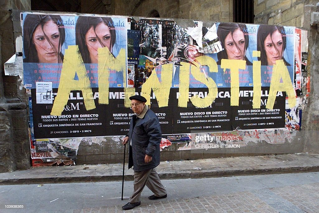 A man passes grafitti saying 'amnistia' a reference to ETA members in jail in the streets of Bilbao Basque country in northern Spain 29 November 1999...