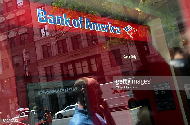 A man passes in front of a Bank of America branch July 21 2008 in New York City Bank of America Corp reported falling profits of 41percent to $341...