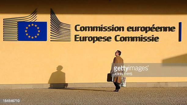 A man passes in front of the building Berlaymont at the EU Headquarters in Brussels on October 22 2012 AFP PHOTO/JOHN THYS